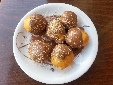 loukoumades with chocolate sauce and sesame